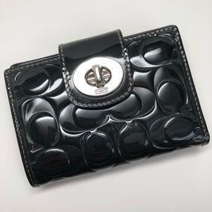 COACH Embossed Signature Turnlock Black Wallet